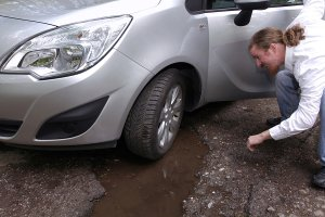 Driving Safely Over Potholes | Rim Doctor